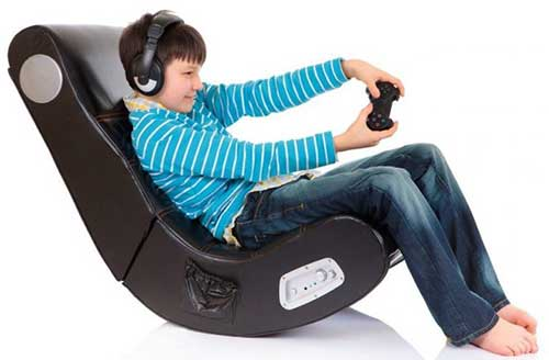 An Image of Playing Game on Gaming Chair for Different Types of Gaming Chairs