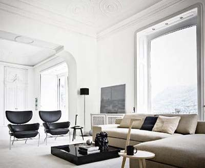 Franco Albini's 836 Tre Pezzi Armchair Upholstered With Black Fabric in a contemporary Living Room