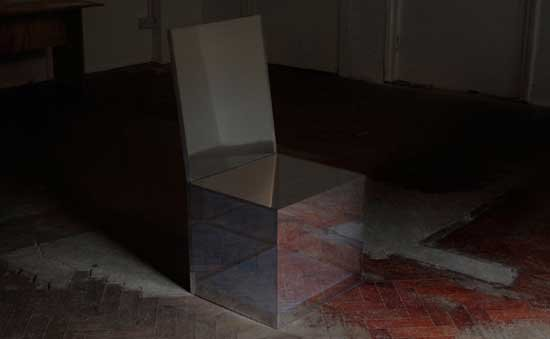Side view of the Affinity Chair, a mirror-like chair reflecting its surroundings to appear invisible