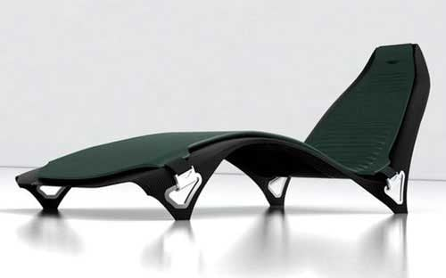 A sleek, green Aston Martin Lounge Chair