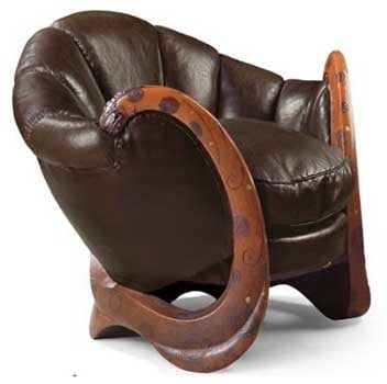 An image of Eileen Gray's Dragons Armchair decorated with spiraling wooden armrests and shell-shaped dark brown backrest