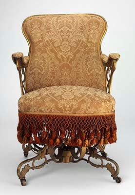 An image of Thomas E. Warren's Centripetal Spring Armchair made of ornately moulded cast iron and decorated with Victorian design elements