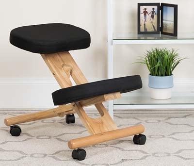 Home set up of Flash Furniture Ergonomic Kneeling Chair on a carpeted floor in Black