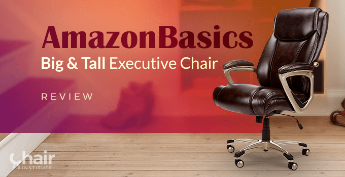 The AmazonBasics Big & Tall Executive Chair on a wooden floor with shoes and stairs in the background