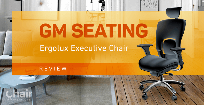 The GM Seating Ergolux Executive Chair in a living room with a wood floor