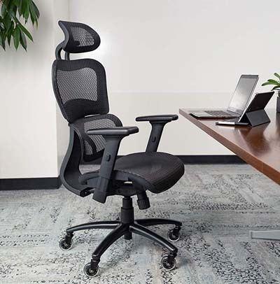 An image of NOUHAUS Ergo3D Ergonomic Chair in an office on top a gray carpet