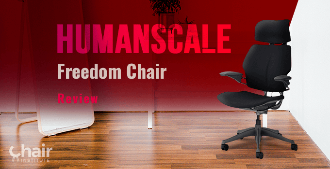 The Humanscale Freedom Chair with a table at the back and a mirror stand