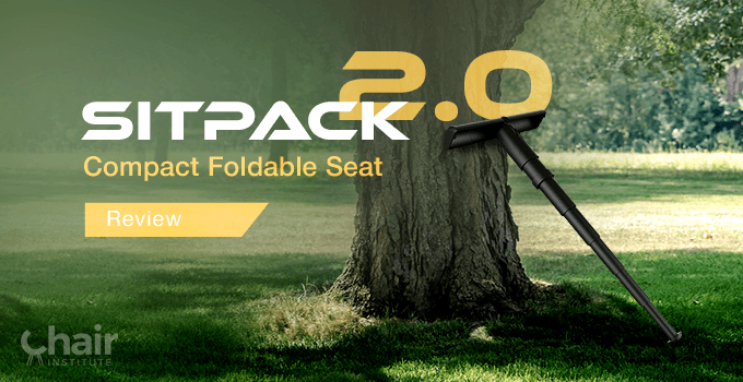 The SitPack 2.0 Compact Foldable Seat leaning on a tree
