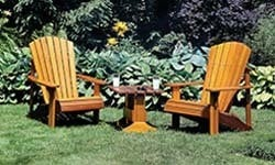 A small image of Modern Adirondack Chairs placed in a garden